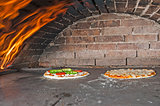 Pizzas cooking in an oven