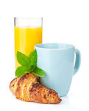 Cup of coffee, orange juice and fresh croissant