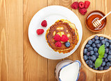 Pancakes with raspberry, blueberry, milk and honey syrup