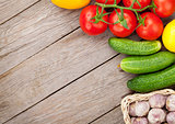 Fresh ripe vegetables on wooden table