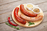 Various grilled sausages with condiments