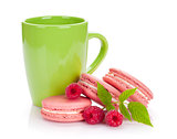 Pink raspberry macaron cookies and cup of drink