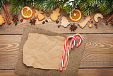 Christmas background with snow fir tree, spices, gingerbread coo