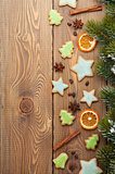 Christmas background with snow fir tree, spices and gingerbread