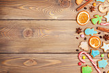 Christmas background with candies, spices and gingerbread cookie