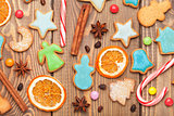 Christmas background with spices and gingerbread cookies