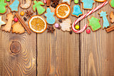 Christmas wooden background with spices and gingerbread cookies