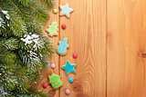 Christmas background with snow fir tree and gingerbread cookies