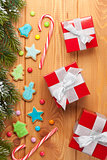 Christmas background with snow fir tree, gingerbread cookies and