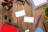 Office table with notepad, colorful pencils, supplies and busine