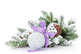 Christmas bauble with purple ribbon and fir tree