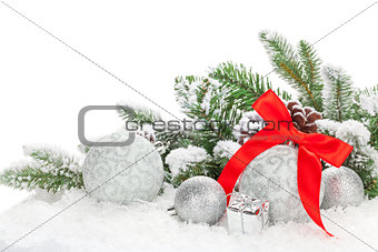 Christmas baubles with red ribbon and fir tree