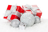 Christmas baubles and red gift boxes