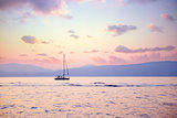 Luxury sailboat in sunset light