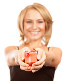 Happy woman giving gift box