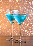 glasses of fresh blue cocktail with ice on bar table