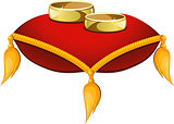 Wedding rings on a red pillow