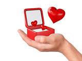 Hand hold hearts in a gift box on white background