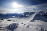 Snowy mountains and view on off-piste slope