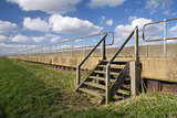 View along the sea wall on Canvey Island, Essex, England