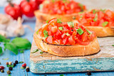 Italian tomato bruschetta with basil