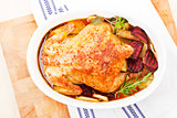Baked chicken in baking dish. Top view.