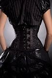 Rear view of young woman wearing elegant black corset