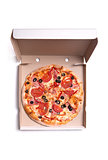 Tasty pizza with ham and tomatoes in box