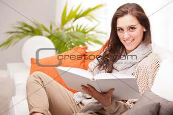 beautiful fascinating woman reading a book