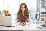 Portrait of happy business woman in modern office