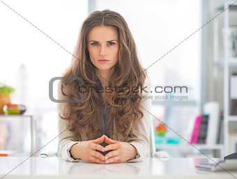 Portrait of serious business woman in modern office