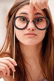 girl having fun with carton glasses