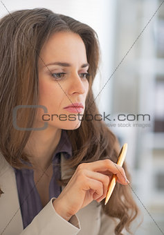 Portrait of thoughtful business woman