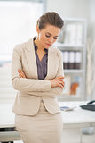 Portrait of thoughtful business woman standing in office