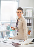 Portrait of happy business woman working in office