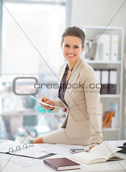 Portrait of happy business woman working in office