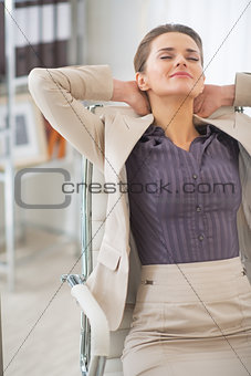 Portrait of relaxed business woman at work