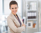 Portrait of smiling business woman in modern office