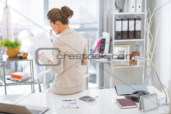 Business woman working. rear view