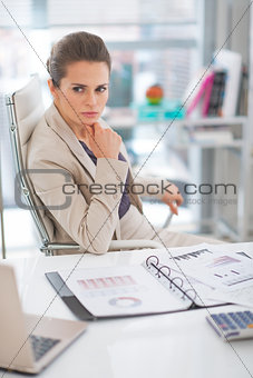 Portrait of thoughtful business woman in modern office