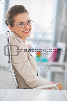 Portrait of happy business woman with eyeglasses in office