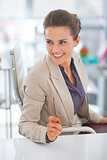 Happy business woman with eyeglasses in office