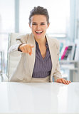 Happy business woman pointing in camera