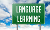 Language Learning on Green Highway Signpost.