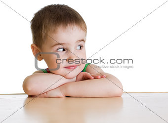 Boy sitting at table isolated