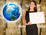 Businesswoman hold paper sheet. Earth and wall of cardboard boxes