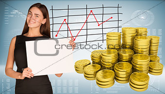 Business woman hold empty paper. Stacks of gold coins