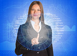 Businesswoman pointing her finger on glowing spiral