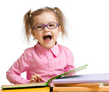 Funny kid girl in glasses with books speaking something isolated