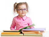 child girl in glasses reading book